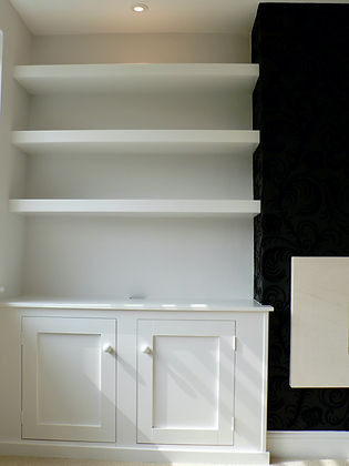 built-in chunky floating shelves above 2 door alcove cupboard