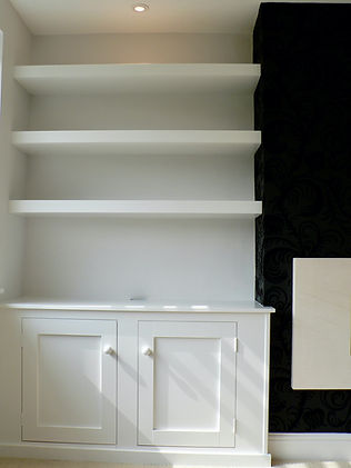 built-in Shaker style 2 door alcove cupboard with floating shelves above