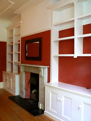 built-in pair of 3 door alcove cupboards and split bookcases