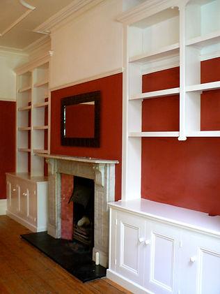 built-in pair of 3 door alcove cupboards and split bookcases