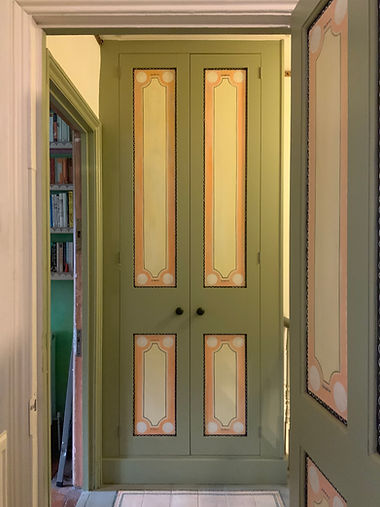 built-in two door wardrobe, airing cupboard in hallway with Bloomsbury style decoration