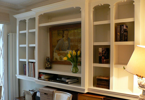 built-in breakfront bookcase, decorative cubby holes