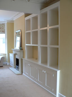 built-in Shaker style 4 door alcove cupboard and modern cubbyhole shelving