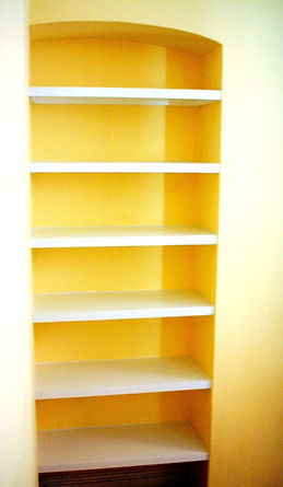 built-in painted shelving in alcove