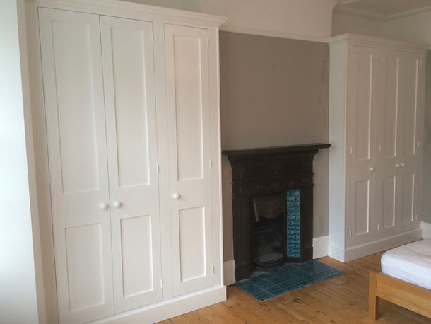 built-in Shaker style pair of three door wardrobes in alcoves