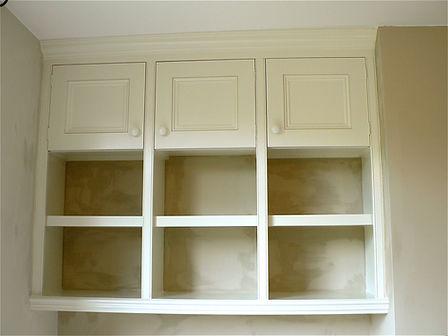 built-in alcove cubby hole bookcase with three door top cupboards