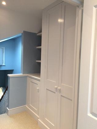 built-in Shaker style two door wardrobe, two door alcove cupboard and floating shelves