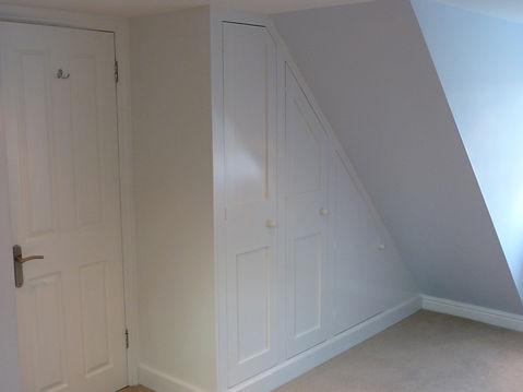 built-in Shaker style under-eaves sloping three door wardrobe