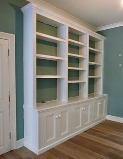 built-in Victorian style 6 door alcove cupboard and split 3 section bookcase