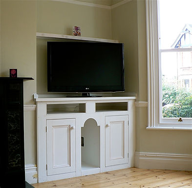 built-in gothic alcove cupboard with slots for speaker and hi-fi units for tv