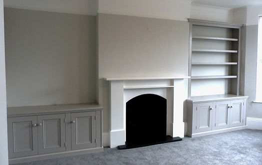 built-in pair of three door alcove cupboards one with bookcase