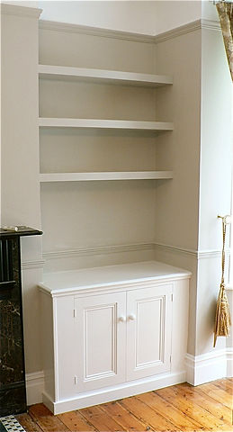 built-in floating shelves and 2 door alcove cupboard