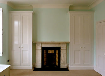 fitted pair of painted two door wardrobes