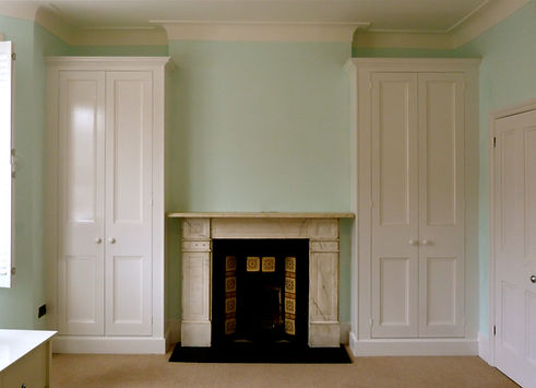 built-in pair of Victorian style two door wardrobes in alcoves