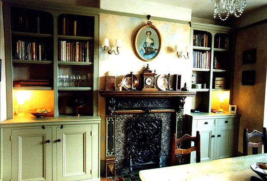 built-in pair of alcove cupboards with split bookcases in decorative Victorian style