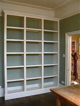 built-in painted bookcase in three sections