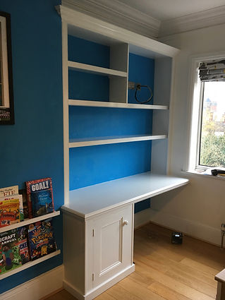 built-in desk, cupboard and split bookcase in large bedroom alcove