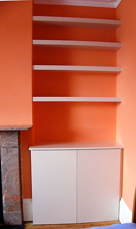 built-in floating chunky shelves and 2 flat door modern alcove cupboard
