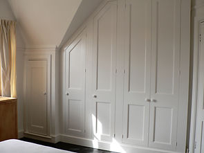 built-in painted under-eaves Shaker style wardrobe