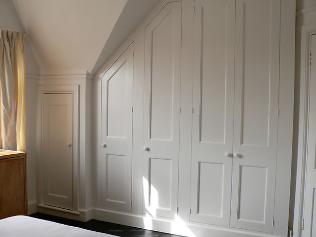 built-in under-eaves, sloping, 4 door wardrobe plus small cupboard in attic bedroom wardrobe