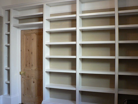 built-in wall to wall library bookcase enclosing doorway