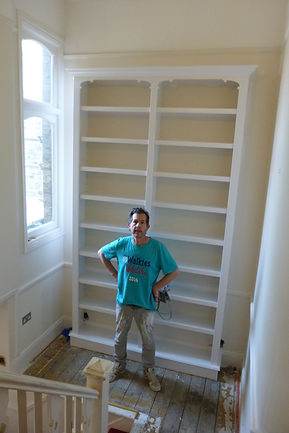 built-in split bookcase on hall landing
