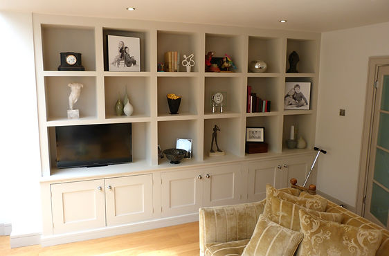 built-in painted chunky shelf unit with 6 door Shaker style alcove cupboards below