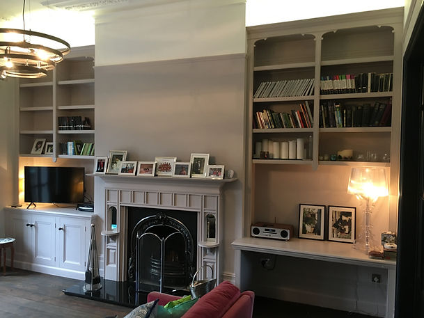 built-in 3 door alcove cupboard and desk with decorative split bookcases above