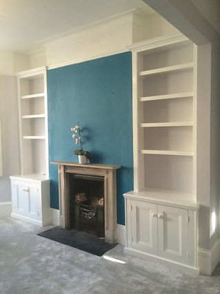built-in pair of traditional 2 door alcove cupboards and bookcases
