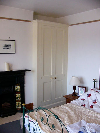 built-in Shaker style two door wardrobe in alcove