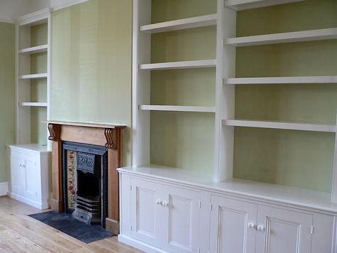 built-in 4 door alcove cupboard with split bookcase and 2 door alcove cupboard and bookcase