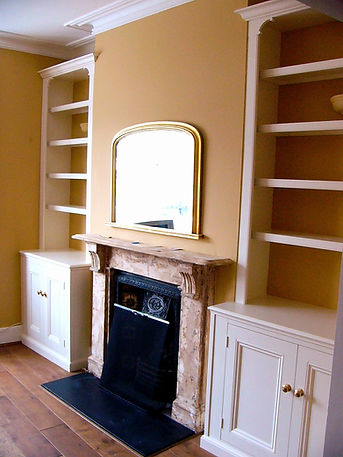 built-in pair of painted two door alcove cupboards and bookcases
