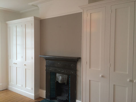 built-in pair of Shaker style three door wardrobes in alcoves