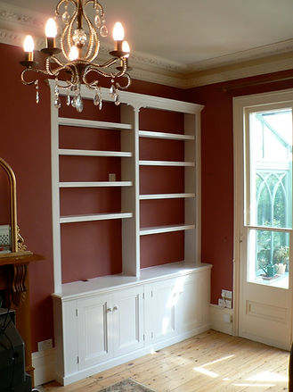 built in 4 door alcove cupboard with split bookcase in Victorian style