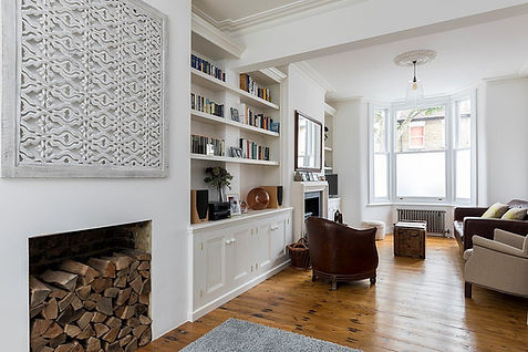 built-in 4 door alcove cupboard and bookcase and 2 door alcove cupboard and bookcase in large open plan lounge