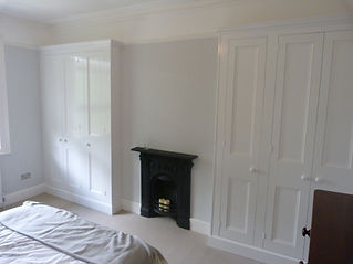 fitted pair of painted 3 door wardrobes