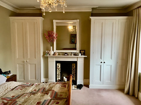 built-in pair of wardrobes, 4 door and 2 door with traditional Victorian style panelled doors