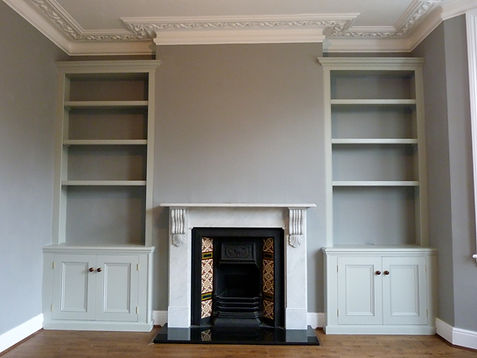 built-in pair of traditional Victorian style alcove cupboards and bookcases