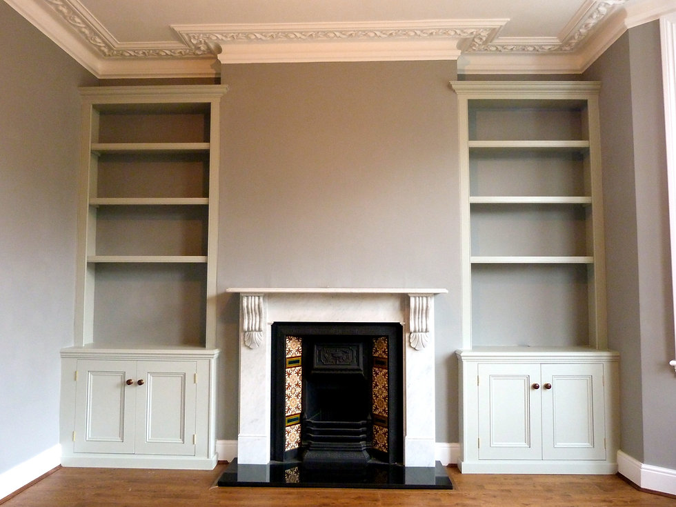 built-in classic pair of painted two door alcove cupboards and bookcases