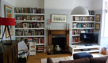 built-in painted chunky shelving bookcases, floating shelves