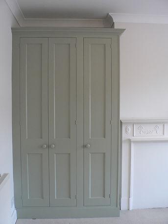 built-in Shaker style three door wardrobe in alcove