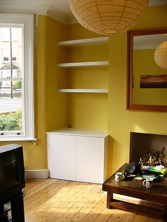 built-in chunky floating shelves above 2 flat door modern alcove cupboard