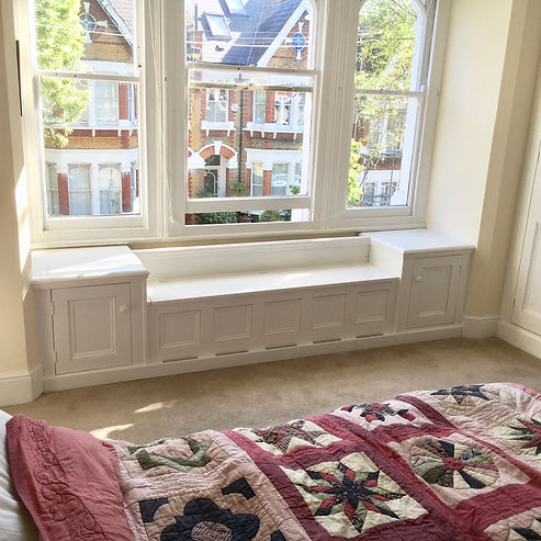 built-in window seat and cupboard storage