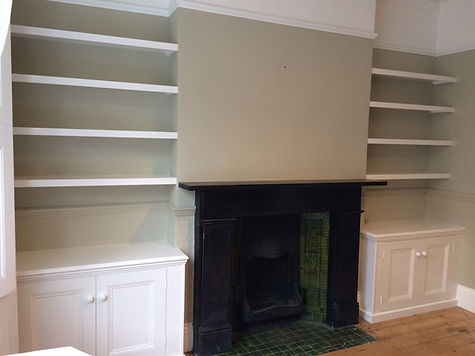 built-in pair of 2 door alcove cupboards with floating shelves above