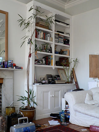 built-in three door alcove cupboard and split bookcase in Victorian style