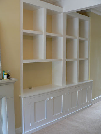 built-in Shaker style 4 door alcove cupboard with modern cubby hole bookcase