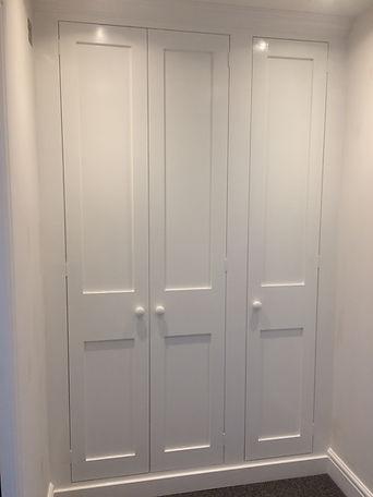 built-in Shaker style three door wardrobe