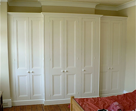 built-in wall to wall breakfront 6 door wardrobe