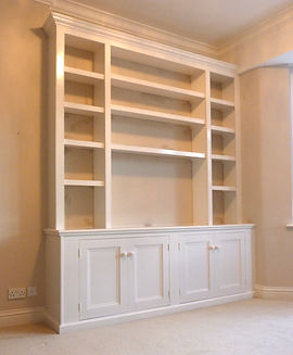 built-in Victorian style 4 door alcove cupboard and 3 section bookcase