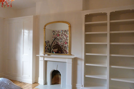 built-in 4 door wardrobe and split full-length bookcase in alcoves